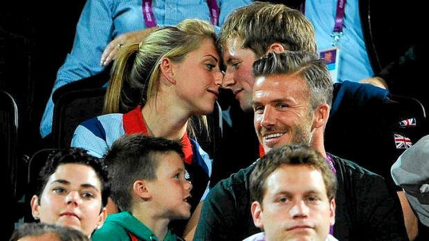 Talk of the tabloids ... British cyclists Laura Trott (left) and Jason Kenny take some attention away from David Beckham ...