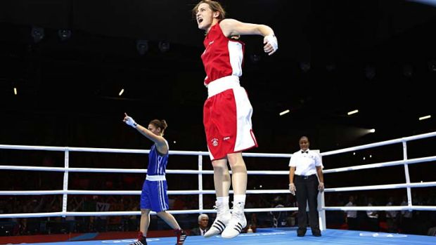 Jumping for joy ... Katie Taylor reacts after being declared the winner.