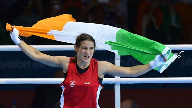 Pride of Ireland ... Katie Taylor celebrates defeating Sofya Ochigava.