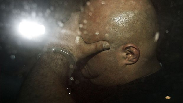 Suddenly camera shy ...Riad Barbour is taken into custody in 2008.