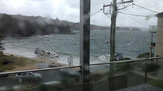 Boats are beached at Little Manly today.
