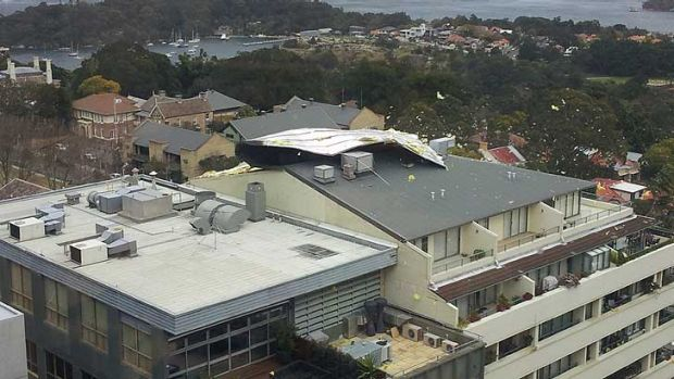 The roof begins to lift off the building in North Sydney.