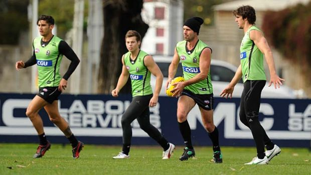 Back in town: Alan Didak (in beanie) yesterday. Didak returns from injury against the top-of-the-ladder Swans.