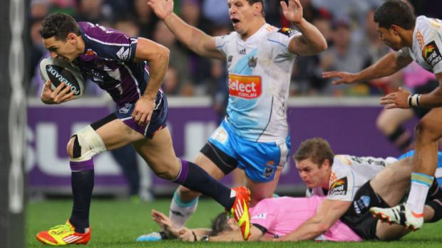 Wrong man ... Billy Slater of the Storm runs in for a try as the referee is tackled.