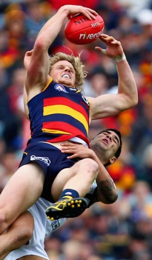 Out of reach... the Crows' Rory Sloane takes the mark over Docker Clancee Pearce at AAMI Stadium.