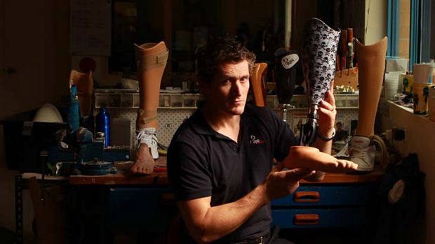 Best foot forward: Cameron Ward with some of his prosthetics.