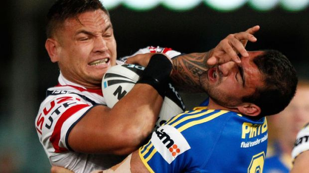 Prop till you drop ... Roosters prop Jared Waerea-Hargreaves is tackled by Eels counterpart Tim Mannah at Parramatta ...