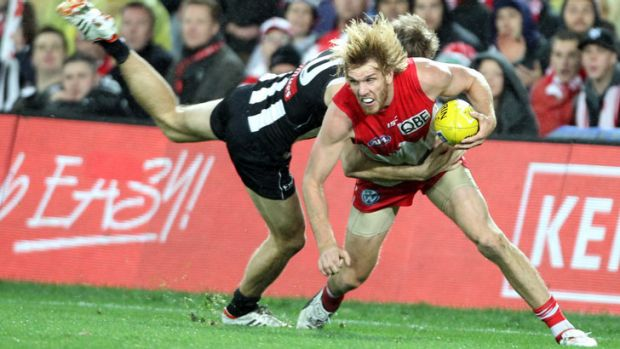 Under pressure ... Lewis Roberts-Thomson of the Swans is tackled by Ben Reid in last night's match against Collingwood ...