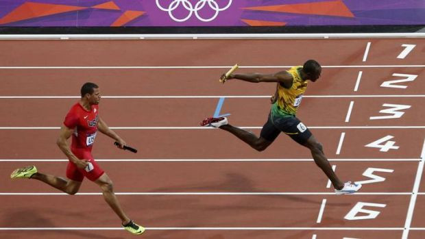 First over the line ... Jamaica's Usain Bolt crosses ahead of Ryan Bailey of the US .