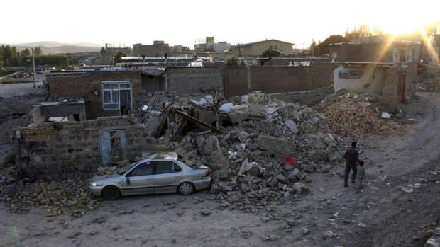 Rubble in the city of Varzaqan, northwestern Iran, after the huge quake.