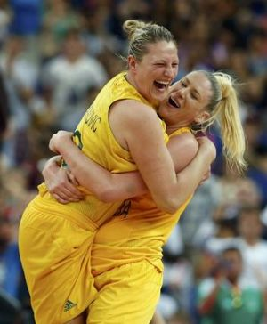 Lauren Jackson, right, celebrates with teammate Suzy Batkovic after the Opals claimed the women's basketball bronze medal.