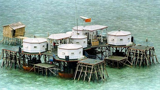 A Chinese flag is prominently displayed in a structure built by China in one of the islands in the Spratlys, in the ...