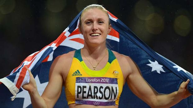 Golden girl ... Sally Pearson after  winning her gold medal.