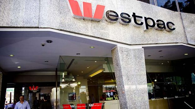 Westpac's full-year net profit result was hit by a tax charge from its buyout of St George.