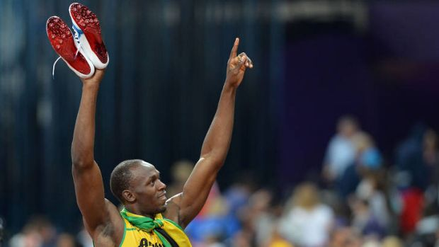 Usain Bolt celebrates after Jamaica's win in the men's 4X100 relay final.