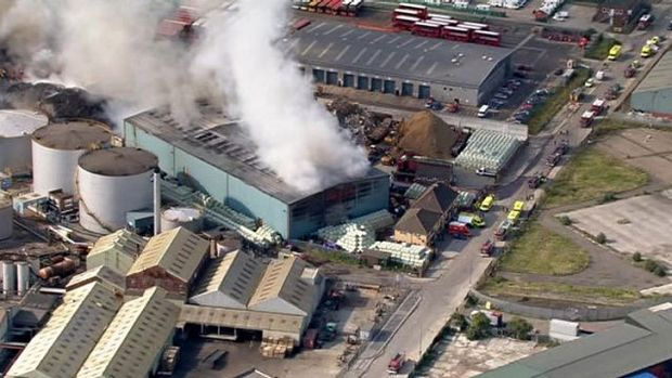 This television screen grab shows the fire in its early stages at a recycling centre in Dagenham, east London.