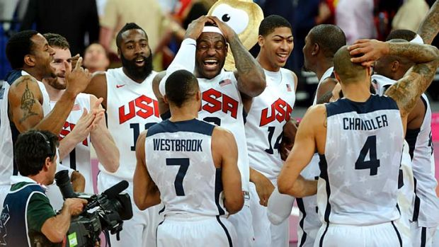 King James holds court ... LeBron James and his team celebrate their gold-medal win against a tough Spain outfit.