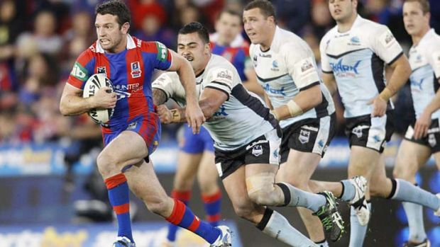 Newcastle's Danny Buderus on the charge for the Knights.