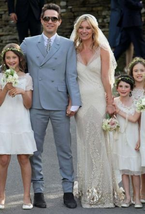 Kate Moss says she is terrible at posing for snapshots - and even found her wedding photos unnatural.