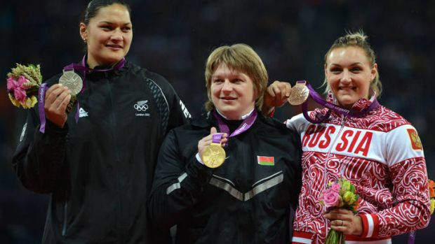 New Zealand's Valerie Adams, left, on the podium with her silver.