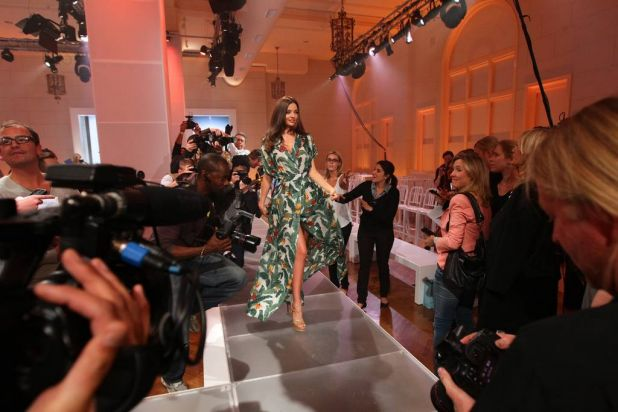 Miranda Kerr models a design by Lisa Ho as she arrives to speak to the media after the dress rehearsal of the David ...
