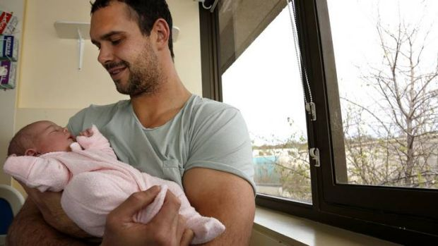 Canberra Raiders player Dane Tilse with his first born baby Ila Rose Tilse born 3.6kg and 49cm at Calvary Hospital.
