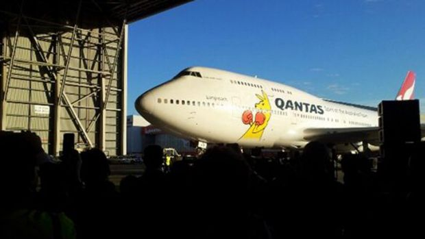 Home at last ... the plane carrying Australia's Olympians pulls into a hangar at Sydney Airport.