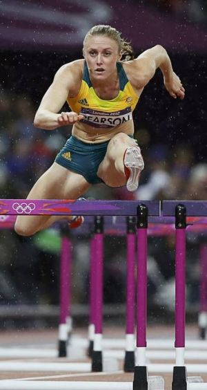 Sally Pearson on her way to winning the women's 100m hurdles final in London.