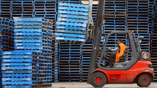 Giving a boost ... the invention of the gas-powered forklift trucks in 1937 led to rise of the pallet.