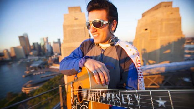 All Shook Up ... Anthony Petrucci marks the anniversary of Elvis Presley's death on top of the Harbour Bridge.