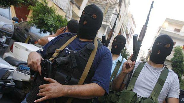 Danger ... gunmen from the al-Mikdad clan parade in Beirut.