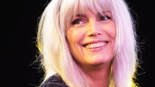 Grey eminence ... Emmylou Harris, 65, keeps her hair long and natural.