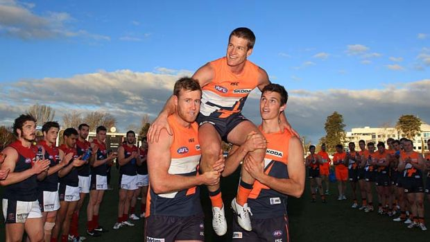 Luke Power is chaired off the ground after joining the 300 club yesterday. ''I was just trying to treat it like any ...