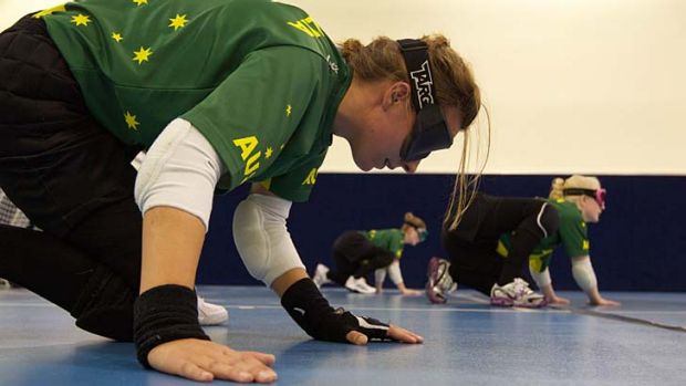 In medal mode ... Australian goalball squad members, from left, Michelle Rzepecki, Tyan Taylor and Jenny Blow train at ...