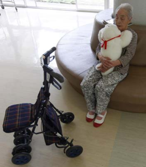 Satsuko Yatsuzaka holds a therapeutic robot named Paro at the Suisyoen retirement home, about 30 km south of the ...