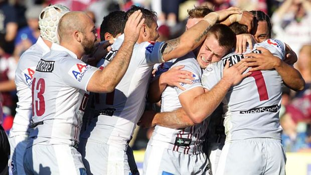 Timing their run ... the Sea Eagles celebrate.