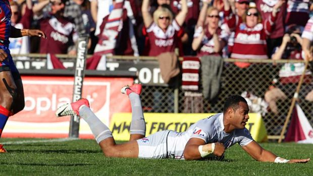 At his best ... Tony Williams scores for Manly during Sunday's win over Newcastle.
