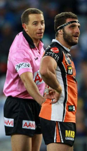Hard done by ... Tigers captain Robbie Farah talks with referee Ben Cummins.