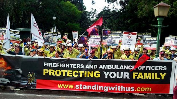 Hundreds of firefighters and ambulance officers stage a noisy demonstration at Parliament House.