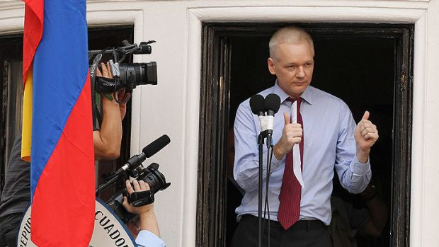 WikiLeaks founder Julian Assange gives the thumbs up sign after speaking to the media outside the Ecuador embassy in ...