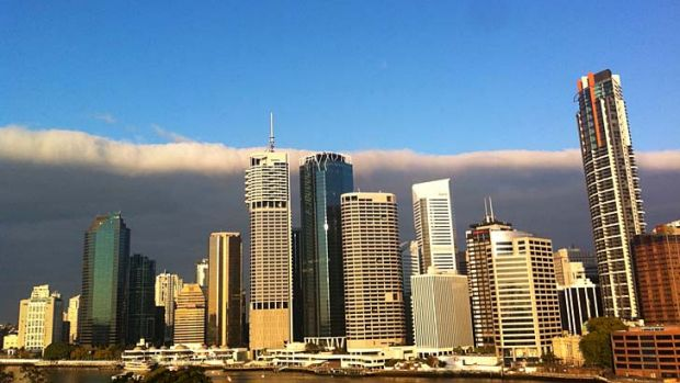 A stratocumulus cloud hangs over Brisbane's CBD.