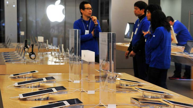 Apple's stores look similar to the new Samsung store but have wood tables.