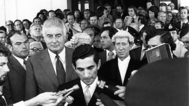 Gough Whitlam listens to David Smith read the proclamation dissolving Parliament in 1975.
