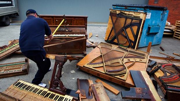Chopsticks ... Paul McDonald sinks his axe into his fifth piano of the day.