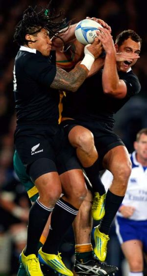 Spot the Wallaby … All Blacks Ma'a Nonu and Israel Dagg fly high.
