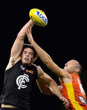 Levi Casboult is spoiled by Suns defender Matthew Warnock.