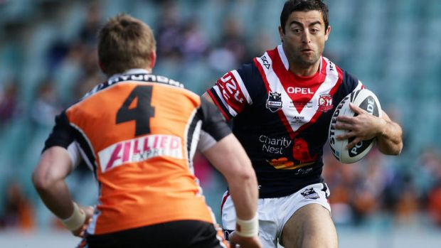 On the attack ...   Anthony Minichiello runs at Chris Lawrence.