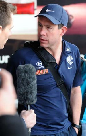 Carlton coach Brett Ratten arrives back in Melbourne.