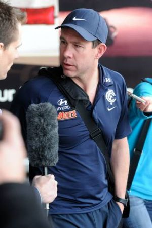Carlton coach Brett Ratten arrives back in Melbourne after the loss to Gold Coast Suns.