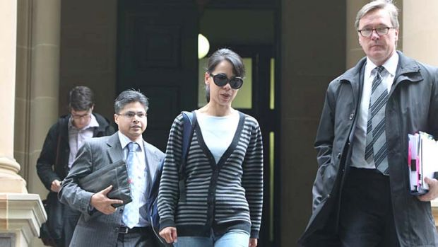 Kathy Lin, wife of  Robert Xie leaves Central Local Court with Mr Xie's barrister, Graham Turnbull, SC, at an earlier ...